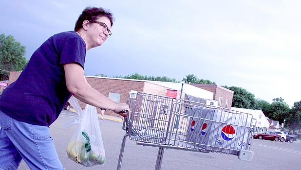 Lois Spanton helps out at Brad's Market.