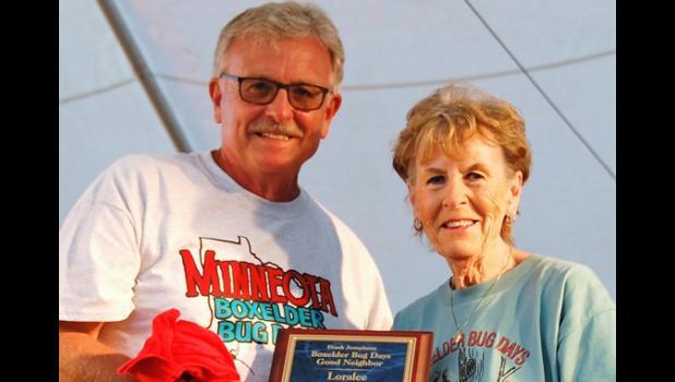 Boxelder Bug Days chairman Scott Josephson presented Loralee Miller with the Good Neighbor award during Boxelder Bug Days.