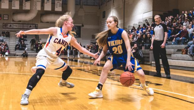 McKenna Yost looks for an opening to drive against the Lancer defense.