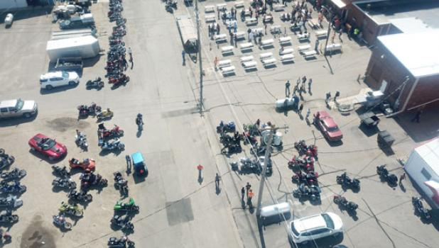 A drone camera captures the many motorcycles and riders that met behind City Hall Bar & Grill Saturday morning before taking off for their 167-mile ride.