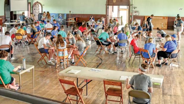 """Members of the group participated in """"Poverty Simulation"""" to get a better idea of what it's like to live below the poverty line."""