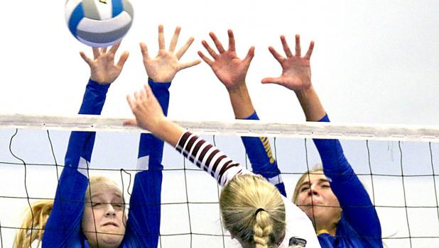 Abby blockers. Abby Rost and Abby Hennen went to the net for a block.