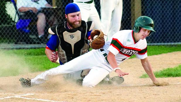 Mudhen Brant Buysse, in a close play, was out at home as the Castlewood catcher made the putout.