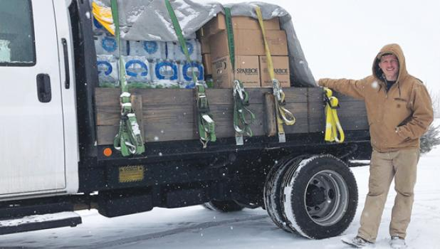 Charlie Pesch left Minneota on Sunday and traveled to Texas with his flatbed truck loaded with bottled water, food and other much-needed supplies that locals donated to help the people of the Lone Star State who were hit hard by a major winter storm.