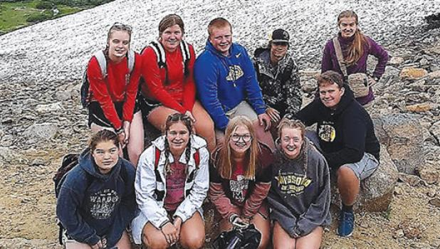 These 10 youths embarked on the pilgrimage to Colorado. Front row, left to right: Kaci Callens, Maddy VanKeulen, Halle Pederson, Natalie Bach, Joe Verschelde. Back row, left to right: Kaitlyn Ludwikowski, Kate Hennen, Lane Loyson, Dylan Vlaminck, Georgia Rabaey.
