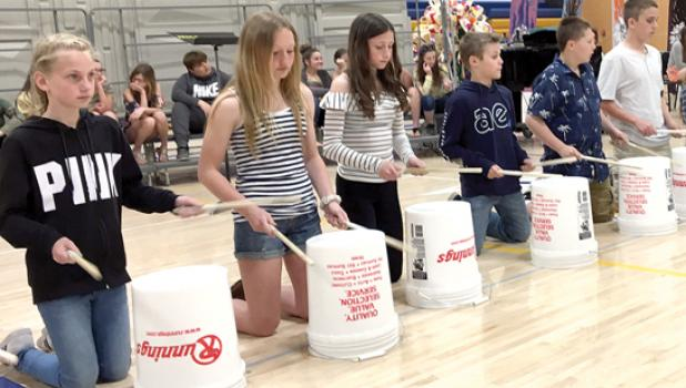"""Minneota Sixth Graders played, """"Surfin' U.S.A."""" by drummin' on buckets during the """"Sun, Sand, Surf,"""" 2019 Elementary Spring Concert at Minneota School last week."""