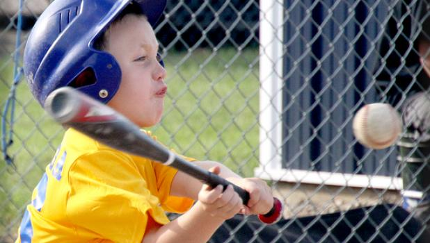 The first and second graders took to the Minneota Field during Summer Recreation Monday night. The girls held a scrimmage-game and the boys were on the other diamond (directly above and to the right. Jacob Swoboda put a little facial expression into hitting the ball during his time at bat Monday night.