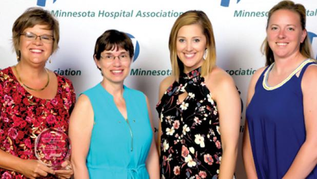 Accepting the Organization Excellence awards were: (left to right) Vickie Abel, Vice President of Organizational Excellence; Cheryl Verschelde, Quality Coordinator; Samantha Kack, Quality Coordinator and Amy Otten, Quality Coordinator.