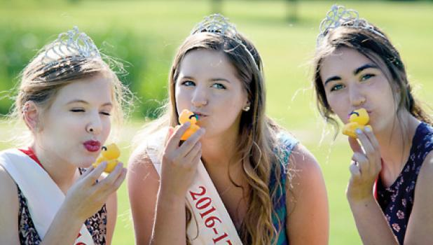 Giving the ducks a kiss for good luck were last year's royalty: (left to right) Queen Sarah Engels and Princesses Baily Kaas and Emily Buysse.