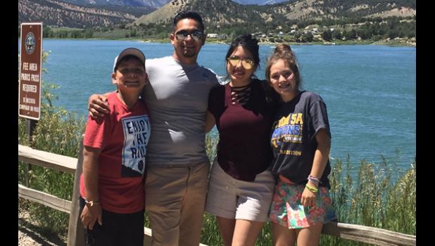 The Ramirez family includes: (left to right) Isaiah, Alvaro, Alexis and Emily.