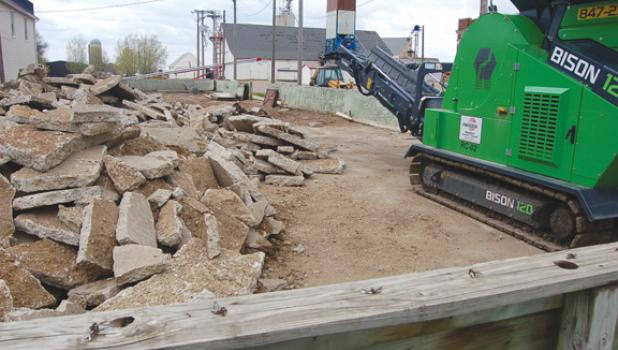 The machine (left) is owned by Kurt Gillund of Rite-Way Drainage. He will be using that machine sometime in May to crush the concrete slabs piled up next to it. This week the fencing around the rink went down.