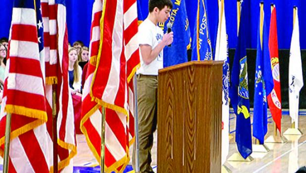 Surrounded by flags, senior Ryan Vlaminck, the Taunton American Legion Boys' Stater gave a presentation to the crowd.