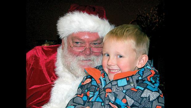 Ryan Porchardt, 3 1/2, of Porter smiled as he sat on Santa's lap inside Bethel Fellowship Church.