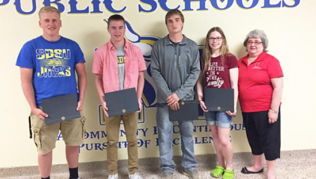 Scholarship winners Mitchell Rost, Tanner Sterzinger, Austin Sterzinger, Rachel Engels and Fran Fier on behalf of the Lincoln County Corn and Soybean Growers.