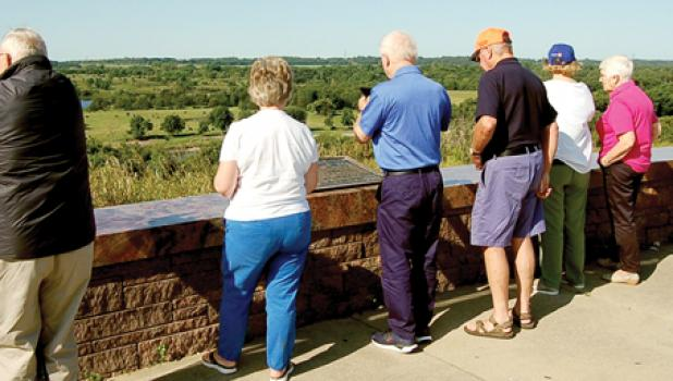 Some of the Scots took photos from the Scenic Overlook off Highway 23 east of Granite Falls on Tuesday morning. Host Alan Dovre of Minneota is on the left.