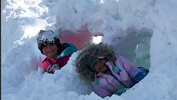 Laney Coequyt (left) and Bentley Walerius (right) found time to build a snow fort after the 15 inches of snow that fell on Saturday night into Sunday.
