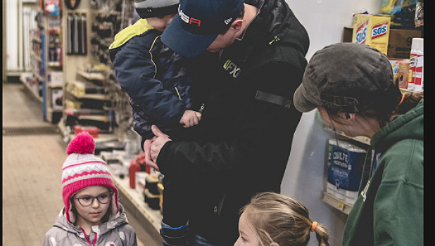 Devin Pohlen and his family purchased an order of cookies from scout Jules Gossen and her mother Shannon at Gislason's Hardware in Minneota on Saturday.