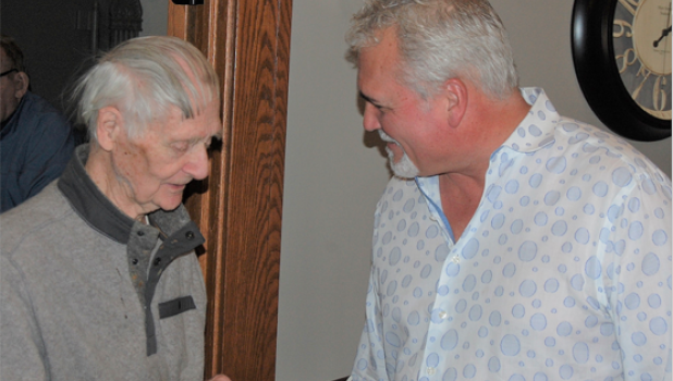 """Daren Gislason, left, talks with Noyes on Saturday at the Minneota Public Library. Noyes penned his short book called """"Ulme': The Sounds of the Shadows of her Hands"""" that includes reflections of Gislason and the late Bill Holm."""