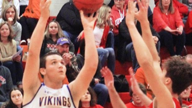 Logan Sussner scores two of his 30 points against an unidentified Luverne defender on Friday night in Luverne.