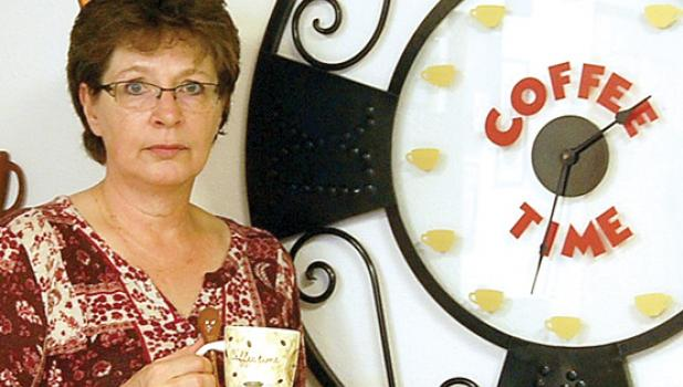 Shirley Gladis has her new coffee shop decorated with items to make the customer feel right at home.