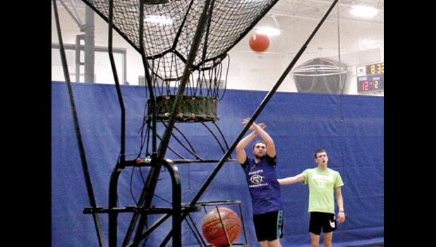 Viking senior Grady Moorse took a shot with teammate Alex Saltzer watching.