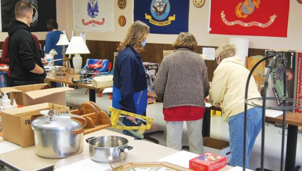 Visitors to the silent auction look over the many items up for bid.