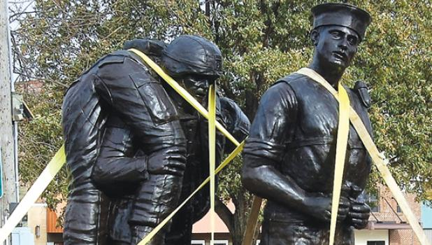 Two military statues arrived Friday in Minneota and will soon be placed in Veterans Park.