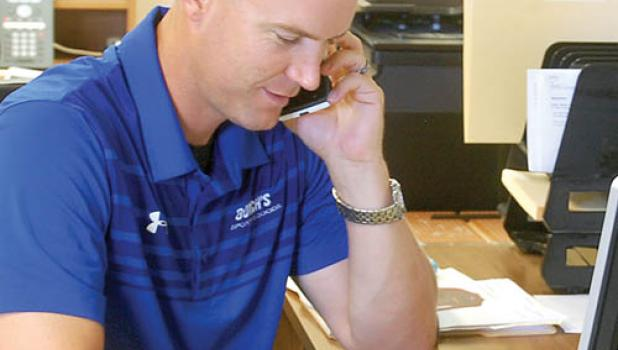 Steve Sussner on the phone at Borch's.