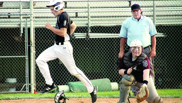 Minneota's Tate Walerius crossed home plate with one of the Vultures' runs in a 12-1 win. Granite Falls catcher Cole Fischer got the ball but it was too late.
