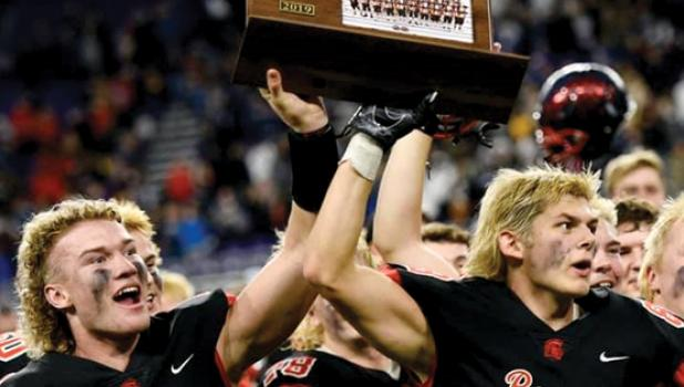 Andrew Anderson (right), Darlene and Vince LeGare's grandson made the winning catch in overtime to help Rocori win the state title. Rocori quarterback Jack Steil, left, and Andrew Anderson hoist the state championship trophy.