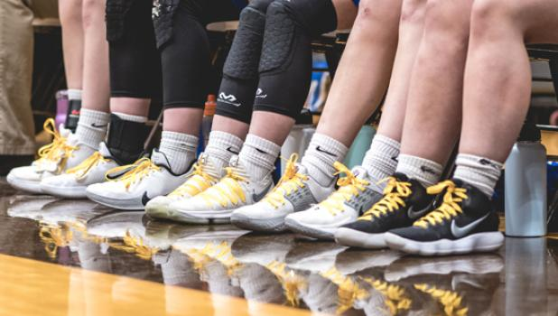 The Minneota players are sporting gold shoe laces to show support for Coach Johnston's niece and childhood cancer.