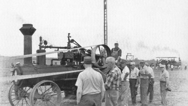 Minneota Rotary members participate in a threshing bee at the Virgil Thompson farm in this 1954-71 photo.
