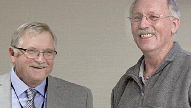 Commission Chairman Gary Crowley (left) presented gifts to Todd Hammer for his 30 years of service to the county.