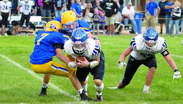 Tucker Thooft and Logan Sussner combine to sack the Lakeview quarterback.