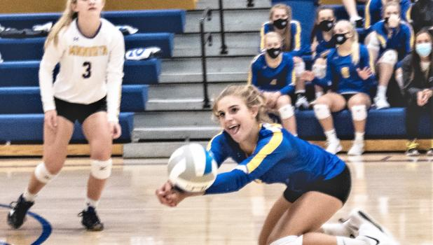 Abby Hennen of Minneota goes low to dig up an attack by Lac qui Parle Valley on Thursday in Minneota.