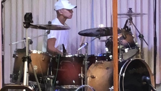 One day after returning home from the hospital, Zeke Monzon was playing drums for his church band