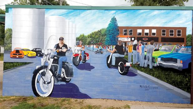 Two years ago, Michelle Koppien was commissioned to paint a 12' x 20' mural on the side of the Roadhouse Bar & Grill in downtown Wabasso by owners Diane and Cay Arends. The Arends' 15-year-old granddaughter was a former art student of Koppien and recommended her to paint the mural.