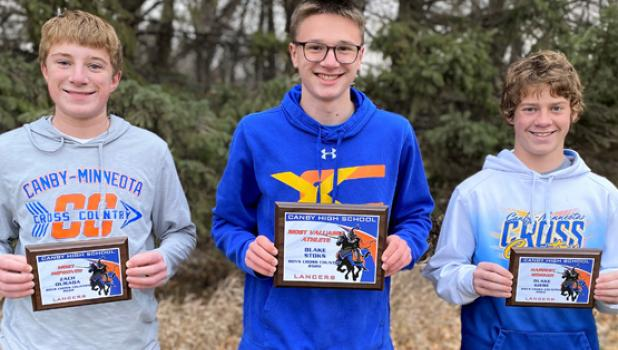 Left to right: Zach Ourada, Blake Stoks and Blake Giese all received awards for their efforts on the Canby/Minneota boys cross country team.