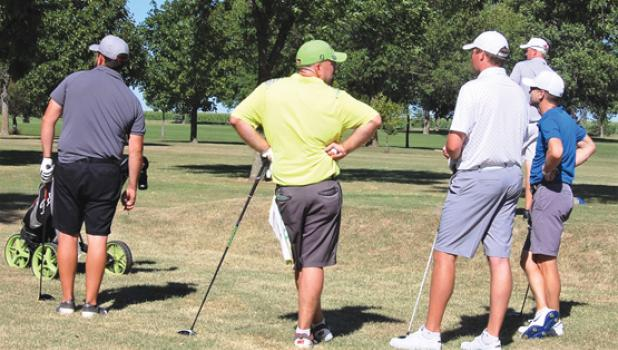 The top five players in the Championship Flight were all paired in the final round.  Left to right: Ben Derynck, Brian Francis, Jacob Baker and Jesse Larson watch eventual champion Matt Bennett tee off (background).