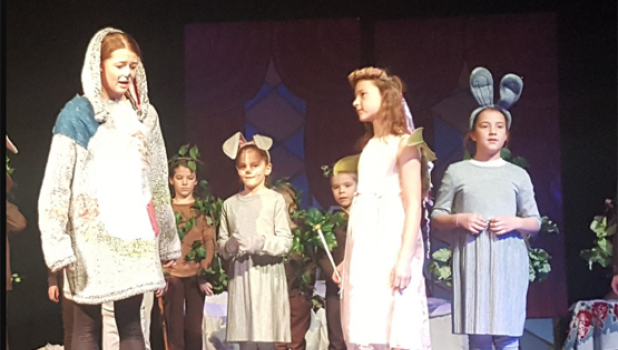 Clara Bader (front, left) playing Velveteen Rabbit before her final transformation in the play. Winifred Swedzinski (front, middle) plays the Nursery Magic Fairy about to change the Velveteen Rabbit into something new. Hildi Swedzinski (front, right) plays a wild rabbit. There was much hopping and excitement on stage.