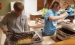 Cole Myhre and Jeren Rost prepare take out meals in the Hope Lutheran Church basement.