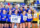 Morgan Kockelman (holding the poster) and her teammates celebrated the Camden Conference Championship and Kockelman's, 2000 assists.