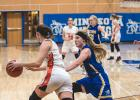 A swarming defense helped the Vikings create turnovers, which led to easy baskets against the Trojans. Ireland Stassen is pictured here.