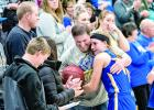 Abby Hennen got a hug from her father Steve, as other family members and friends applauded.