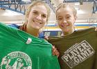 Abby Hennen and McKenna Yost showed off their Player of the Game T-Shirts awarded by announcer Paul Raymo of Q-92 Radio of Madison after Minneota beat MACCRAY, 3-0 for the Camden Championship.