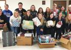 Last year's National Honor Society students helped package and distribute food and gifts for the Christmas Angels program.