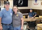 Pam Gregor, right, was the winner of the Minneota/Taunton VFW Scholarship Fund bench that was built and donated by John DeSmet, left.