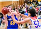 Nolan Boerboom pulled up for a shot at the basket against Canby's Joey Hiedemann.
