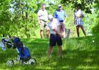 Nolan Boerboom shot out of a tough spot as he shot the ball through a small hole in the trees as his father Shawn Boerboom, Ralph Hagen and mother Heidi (obstructed) watched.