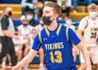 Minneota's Bishop Drietz defends against Yellow Medicine East on Friday night.